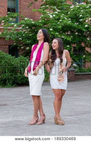 EUGENE, OR - MAY 22, 2017: Best friends and sorotrity sisters pose together for a graduation photo on campus at the University of Oregon in Eugene.