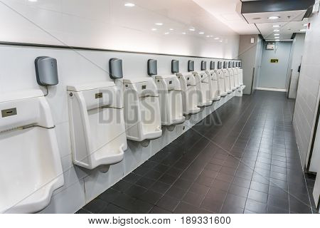 public men toilet room with technology electronic sensor.