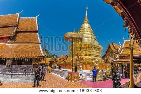 CHIANGMAI - MARCH 6: Locals and tourists come to pray at the Doi Suthep Temple in Chiang Mai, Thailand on March 6, 2017. The temple founded in 1385 is a major landmark tourist attraction in Chiang Mai