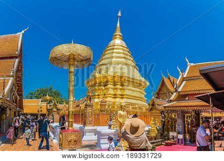 CHIANGMAI - MARCH 6: Locals and tourists come to pray at the Doi Suthep Temple in Chiang Mai Thailand on March 6 2017. The temple founded in 1385 is a major landmark tourist attraction in Chiang Mai