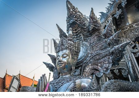 Statue engraved from silver in buddhist temple at Chiang Mai Thailand