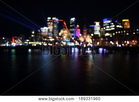 Beautiful scene of colorful bokeh blurred background Sydney city skyline by night at Campbell's Cove.