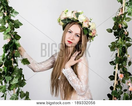 Spring beauty girl with colorful flowers wreath. Beautiful lady with blooming flowers on her head