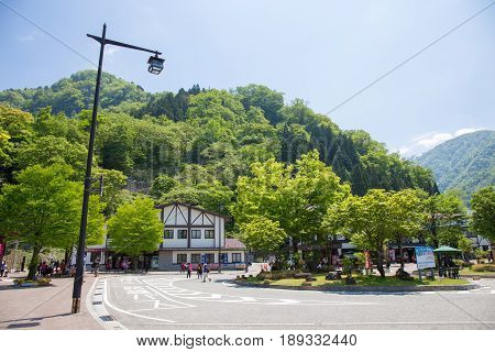 Tateyama - May 10: Tateyama station in Toyama city is interchange tram or tramcar to the japan alps with mountain and blue sky background on May 10 2015 in Tateyama Japan
