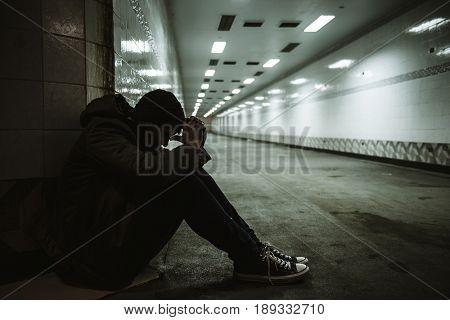 Hopeless Man Sitting Thoughtful on The Floor