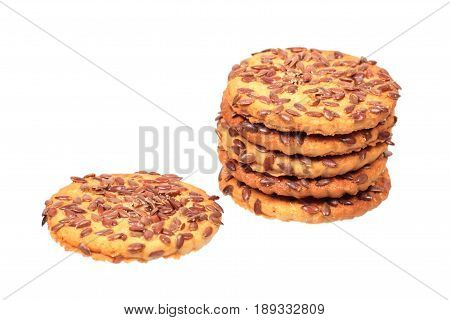 Cookies with flax seeds isolated on white background
