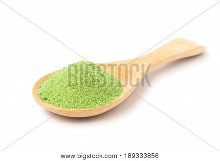 Green matcha tea powder on wooden spoon with white background