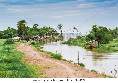 The nature of the Thai peasant village in the atmosphere of bright blue sky and buffalo.