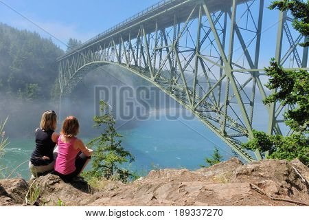 Group meditation by ocean in foggy morning. Deception Pass Bridge Park. Seattle. Anacortes. Washington. United States.