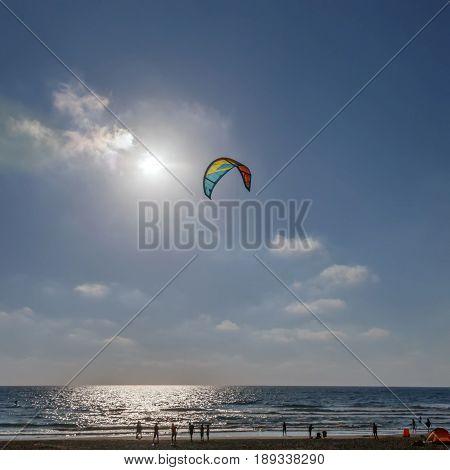 Kitesurfing - Parachute on sky background sunset cloud