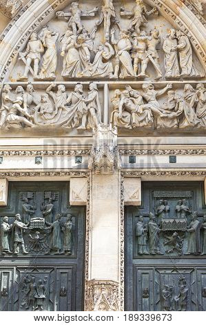14th century St. Vitus Cathedral facade relief gothic portal Prague Czech Republic. It is a Roman Catholic metropolitan cathedral in Prague the seat of the Archbishop of Prague.