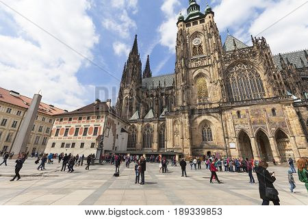 PRAGUE CZECH REPUBLIC - MAY 1 : 14th century St. Vitus Cathedral and Castle courtyard with tourists in sunny day. It is a Roman Catholic metropolitan cathedral in Prague the seat of the Archbishop of Prague.