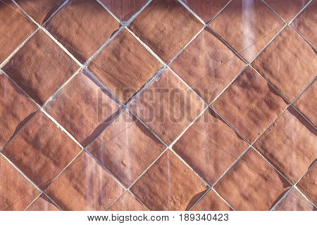 pattern of harmonic cotto tiles in red