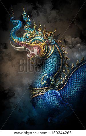 blue naga statue in buddhism temple thailand