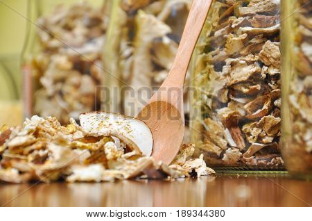 Dried porcini mushrooms. Background with dry mushrooms, boletus edulis as spice for cooking