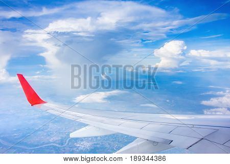 wing airplane and cloud on skyblue transportation