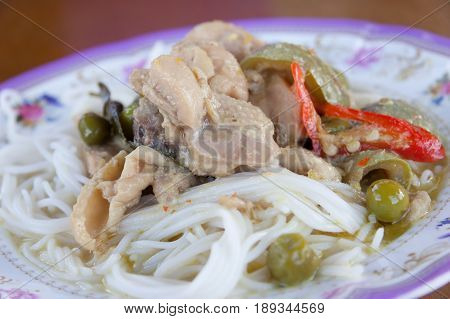Traditional Thai cuisine rice vermicelli with chicken green curry.