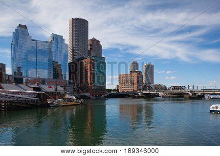 Boston Massachsetts USA - July 2 2016: Boston skyline and Seaport boulevard bridge from Congress Street Bridge Boston USA
