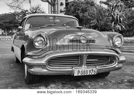 Trinidad Cuba - January 22 2017: Old american car on the road Old Havana Cuba.Thousands of these cars are still in use in Cuba and they have become an iconic view and a worldwide known attraction