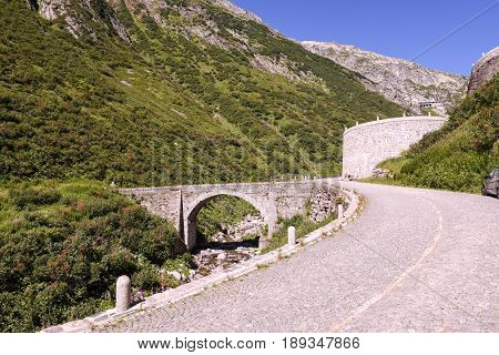 Airolo Switzerland - 7 august 2016: cyclists pedaling on the old road which leads to St. Gotthard pass on the Swiss alps