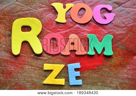 word roam on a  abstract colorful background