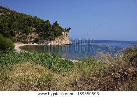 Wild coast in Greece, Aegean Sea, sun day