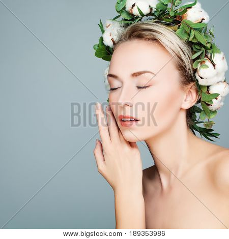 Perfect Model Woman with Healthy Skin on Blue Background. Facial Treatment and Cosmetology