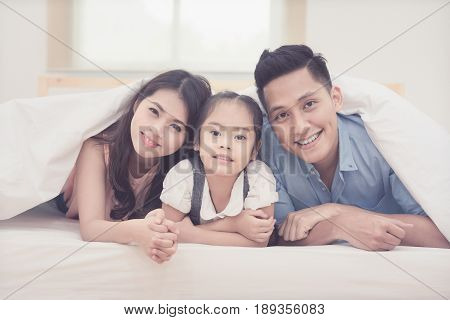 Asian Family Happy Smiling And Relax On Bed At Home. Photo Series Of Family, Kids And Happy People C