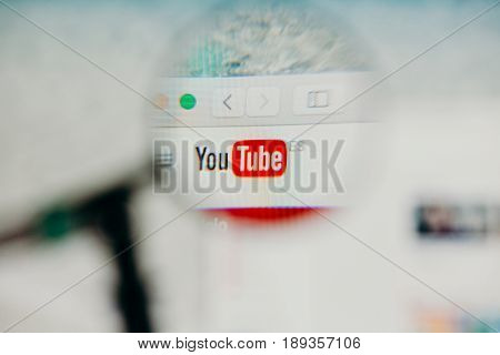 MALAGA, SPAIN - JUNE 3, 2017: Youtube website detail in a computer screen, viewed through magnifying glass. Social video concept.
