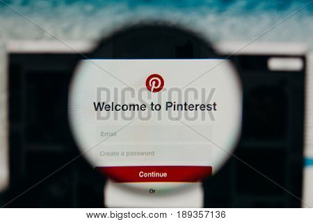 MALAGA, SPAIN - JUNE 3, 2017: Pinterest website detail in a computer screen, viewed through magnifying glass. Social media concept