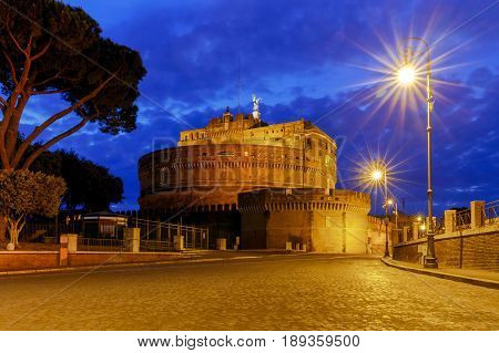 Castel Sant'Angelo and Sant'Angelo bridge across the river Tiber in the night light. Rome. Italy.