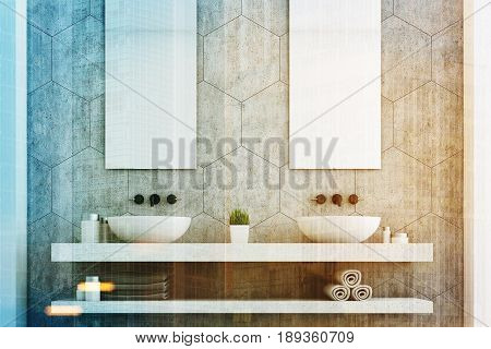 Gray bathroom with a gray wall two white sinks and two tall rectangular mirrors hanging above them. 3d rendering toned image