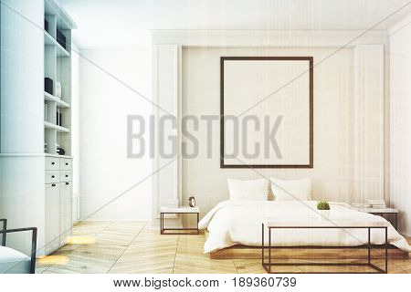 Front view of a white bedroom interior with a double bed a coffee table a bookcase near a wall and a vertical picture on the wall. 3d rendering mock up toned image