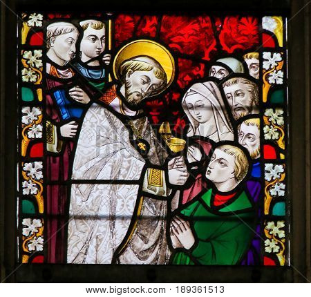 Stained Glass - Priest Giving Holy Communion