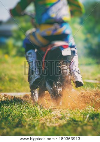 Professional Motocross Rider On The Road. Back View.