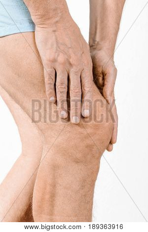 Athlete Man Feeling Pain To The Knee And To The Quadriceps
