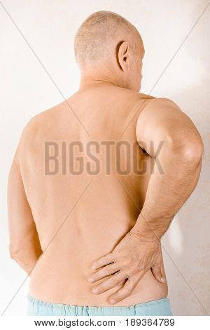 Man Suffering Of Low Back Pain