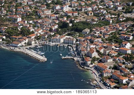 Sutivan settlement on northwest side of island Brac in Croatia view on port and coastline