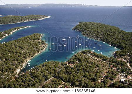 Sailing boats in quiet bay near village Milna on island Brac in Croatia