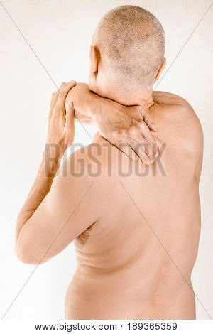 Man Suffering Of Thoracic Vertebrae Or Trapezius Muscle Pain