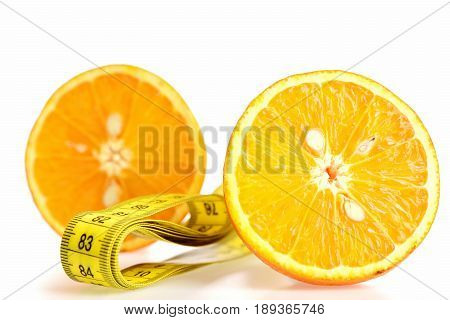 Halves Of Orange Fruit With Folded Yellow Sewing Centimeter