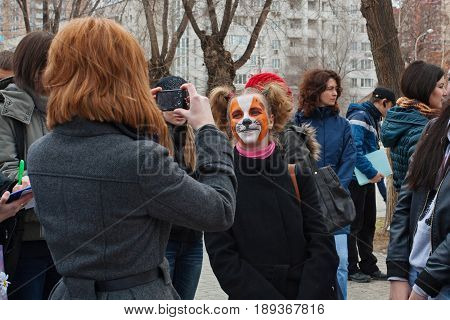 Volgograd Russia - March 31 2012: Person taking a picture of girl in makeup in international action for the protection of animals