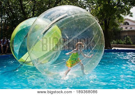 Volgograd Russia - May 29 2010: Little girl stands in a balloon floating on water in city park in Volgograd