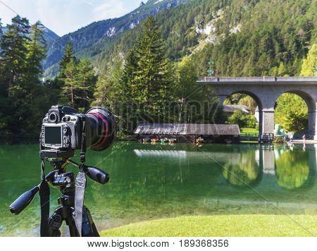 Fernsteinsee, Austria - September 2017: taking pictures at alpine lakes