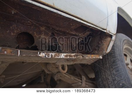 Rusty old car. Severe Rust and corrosion damage from road salt