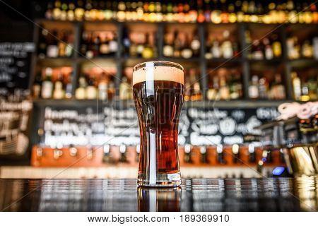 Dark Beer On A Pub Background