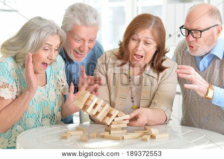 Old people playing board games at home