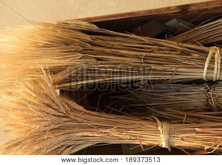Wheat spikes in a wooden box close up