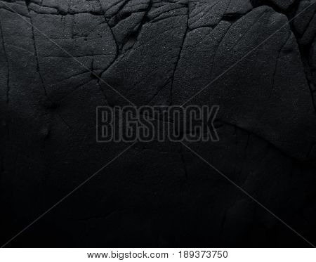 Close up rocks. Dark Stone texture. Black rock.