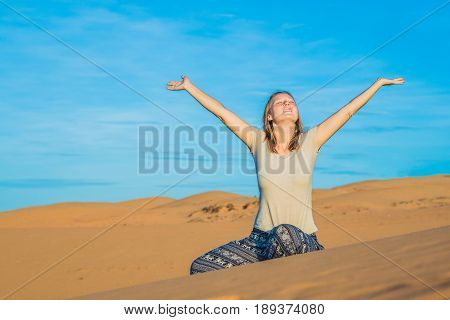 Young Woman In Rad Sandy Desert At Sunset